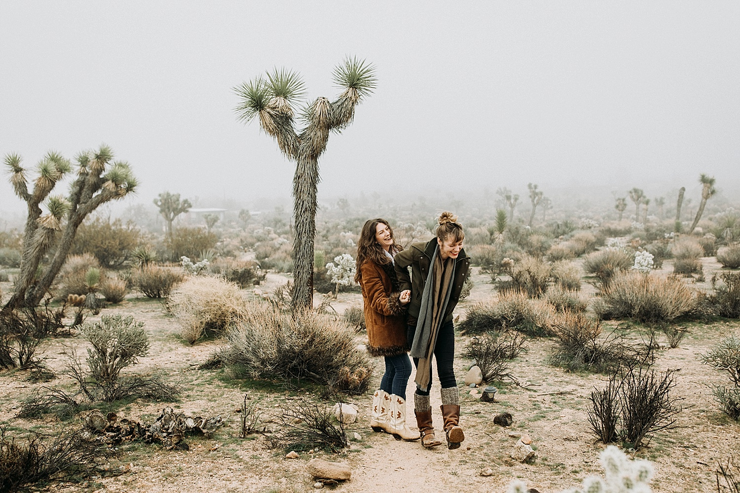 couple walking arm in arm in Joshua Tree, California photography