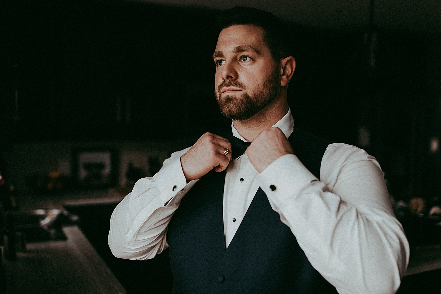 groom adjusting bow tie wedding photography
