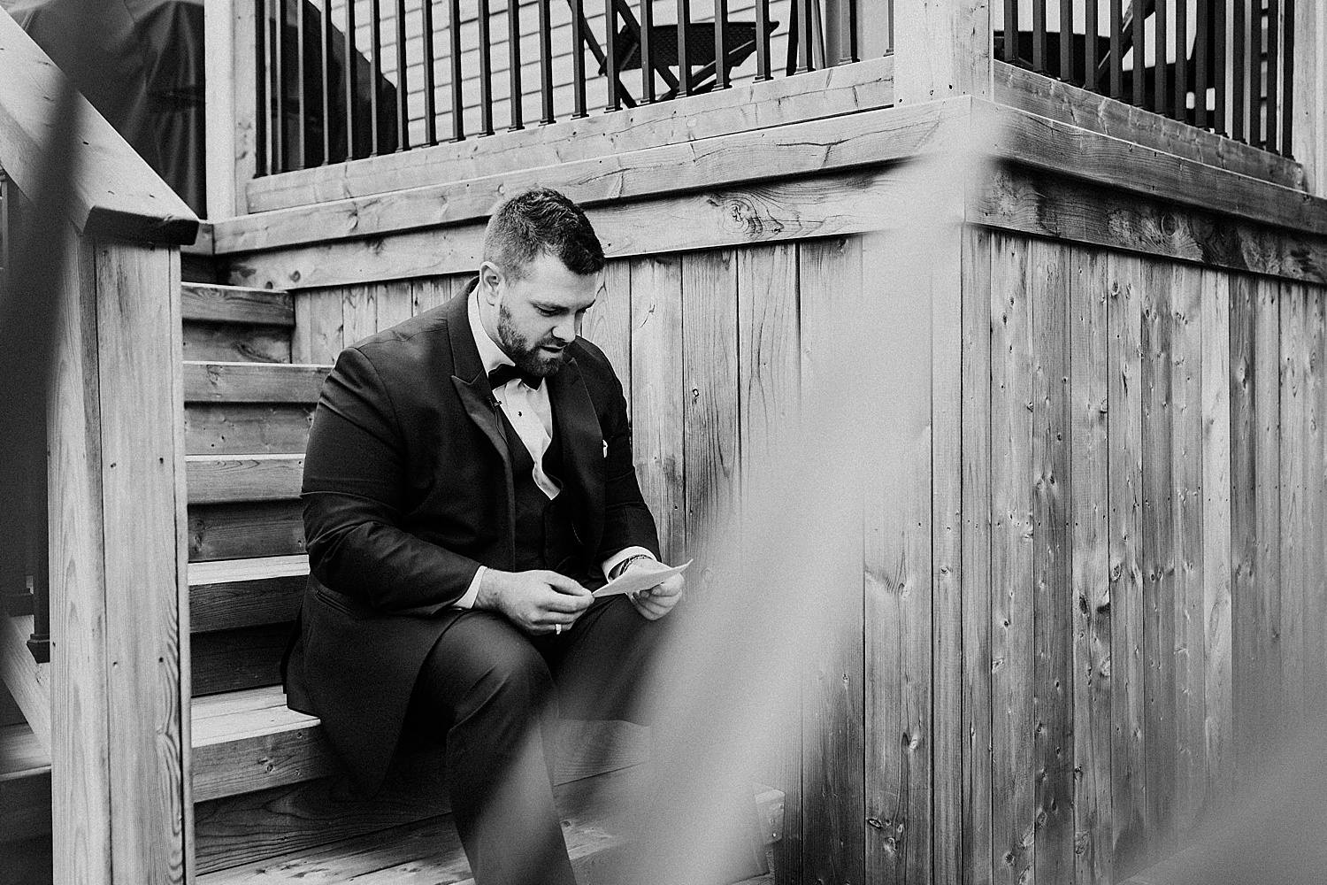 groom reading letter wedding photography