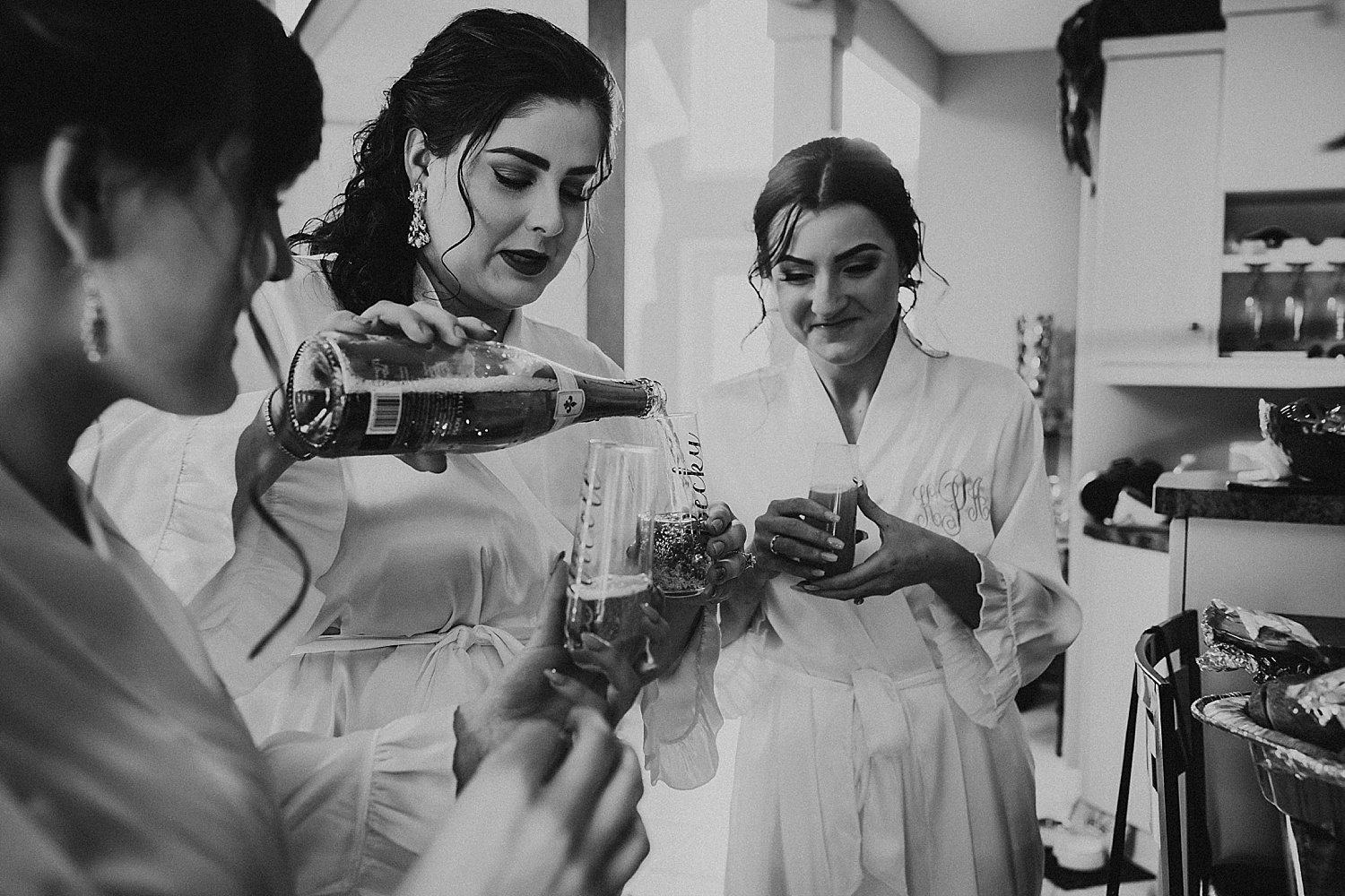 bridesmaids pouring champagne wedding photography