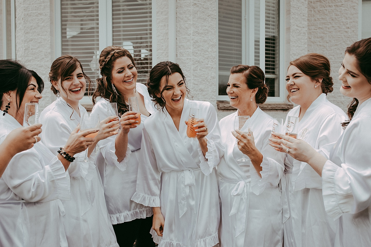 bridesmaids laughing and drinking wedding photography