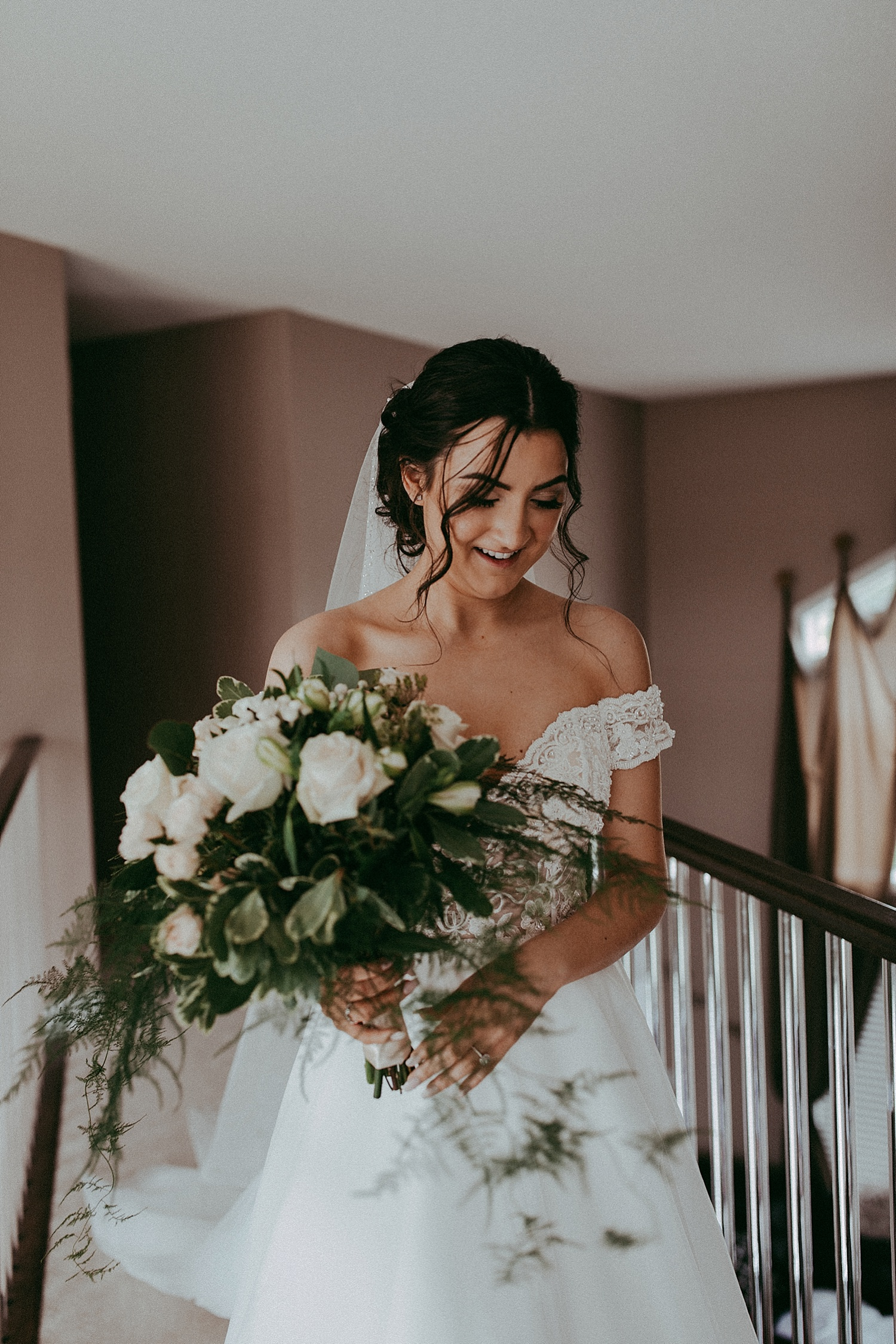 bride holding bouquet of flowers wedding photography