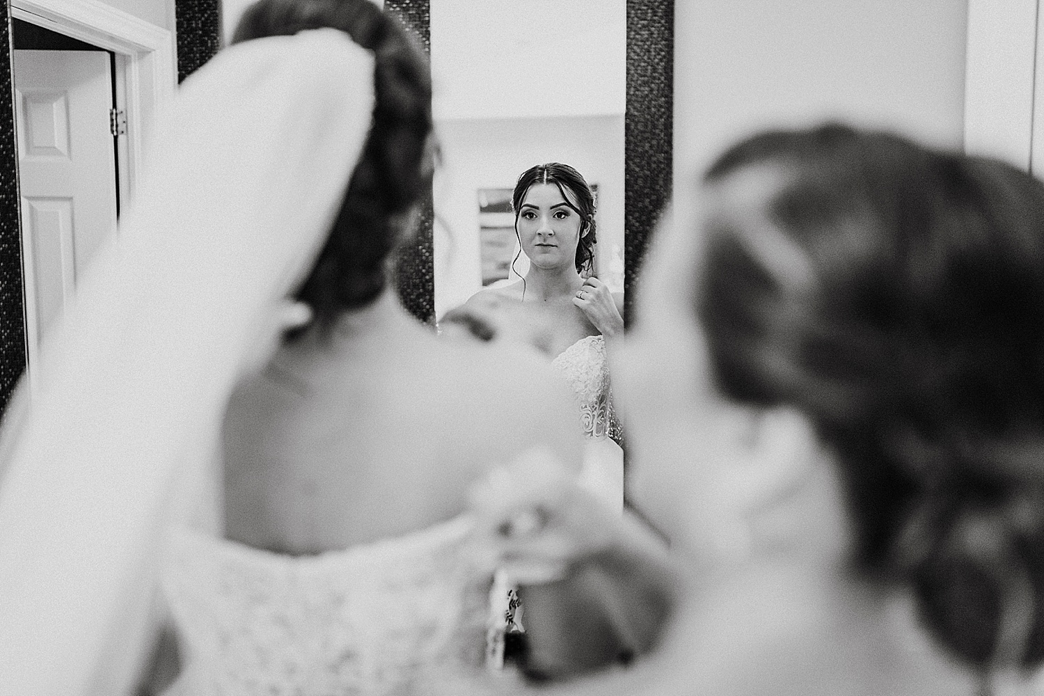 bride looking in the mirror wedding photography