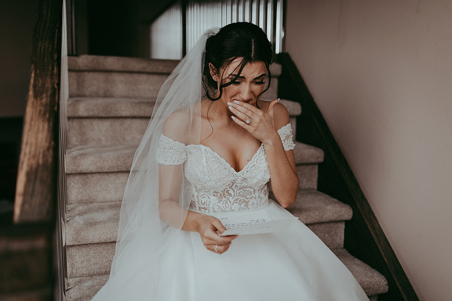 emotional bride reading a letter wedding photography
