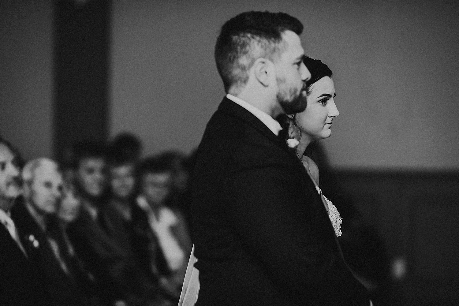 close-up of bride and groom at the alter, wedding photography