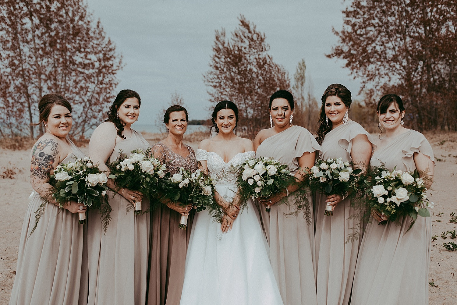 bridesmaids standing in line on beach, wedding photography