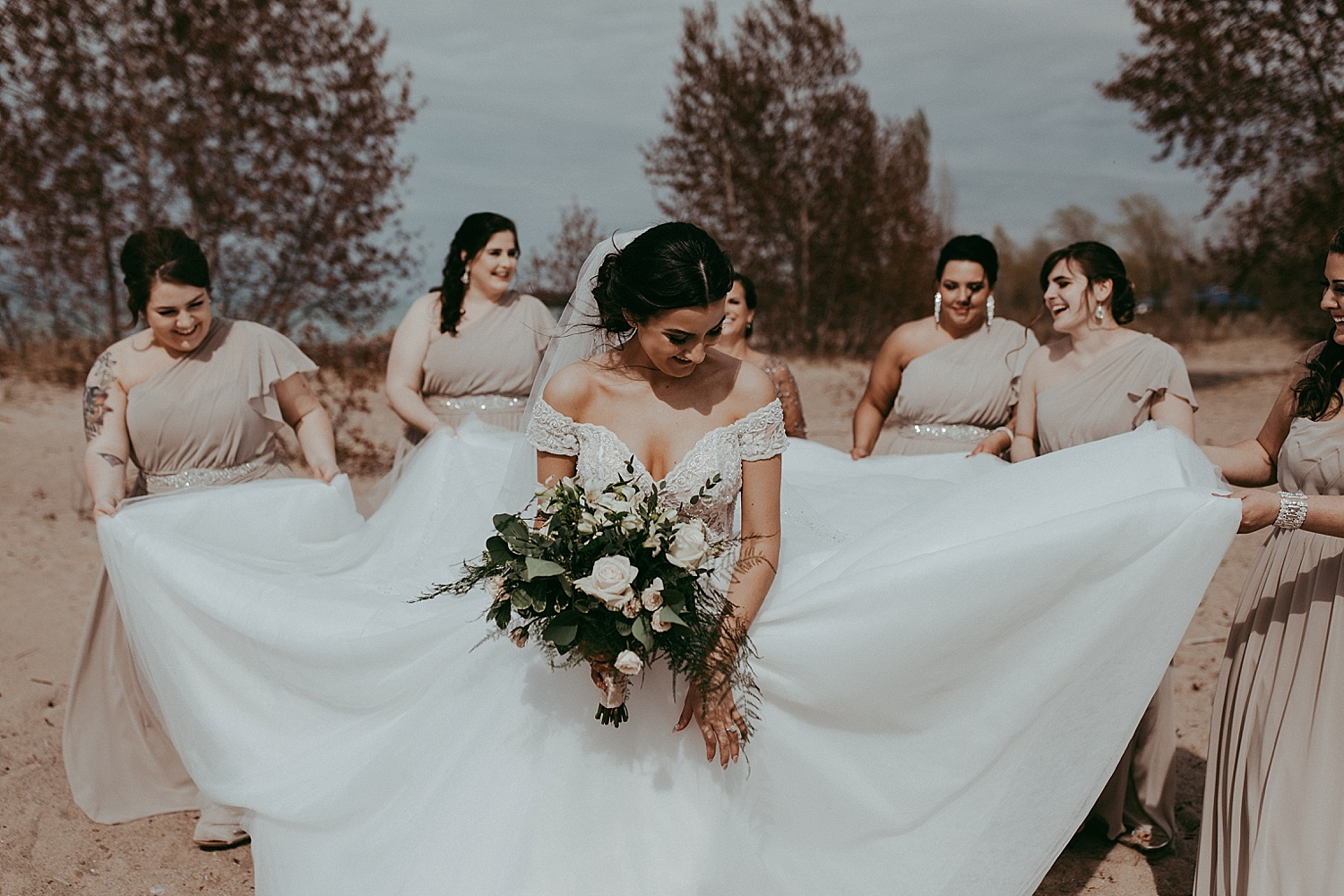 bridesmaids holding the bride's dress, wedding photography