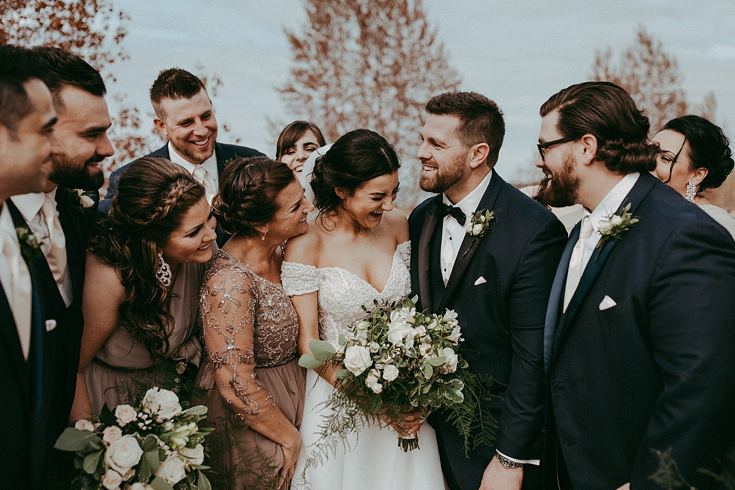 wedding party laughing together, wedding photography