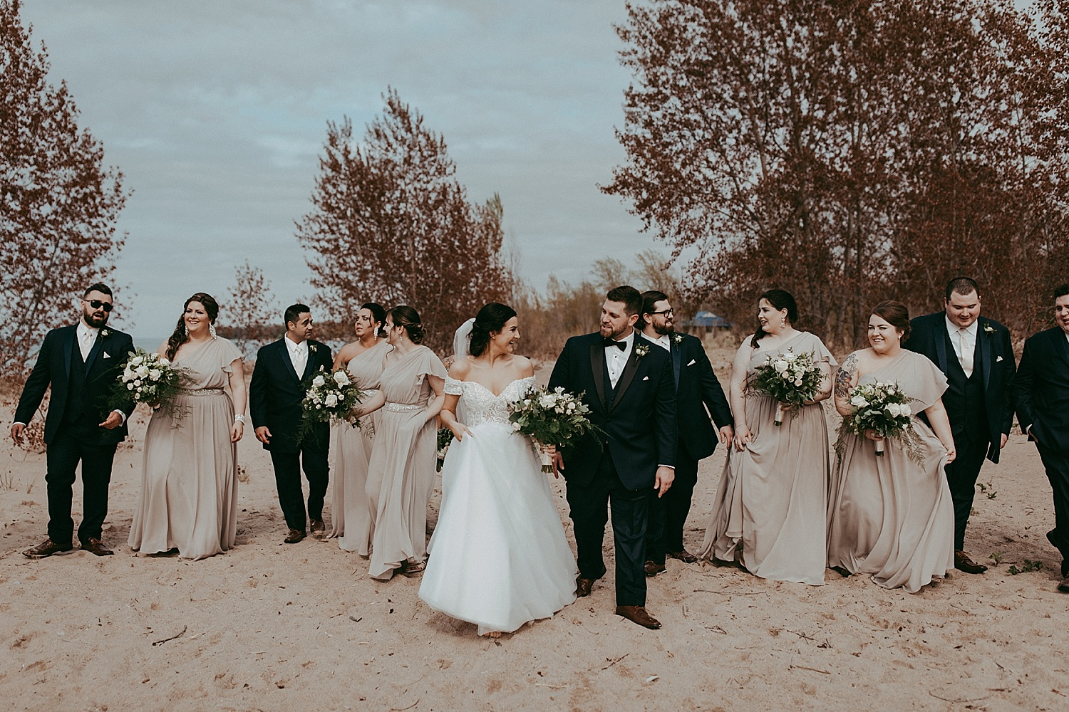 wedding party walking on the beach, wedding photography