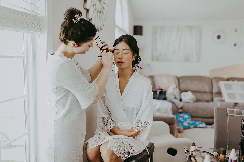 Make-up artist doing the bride's makeup