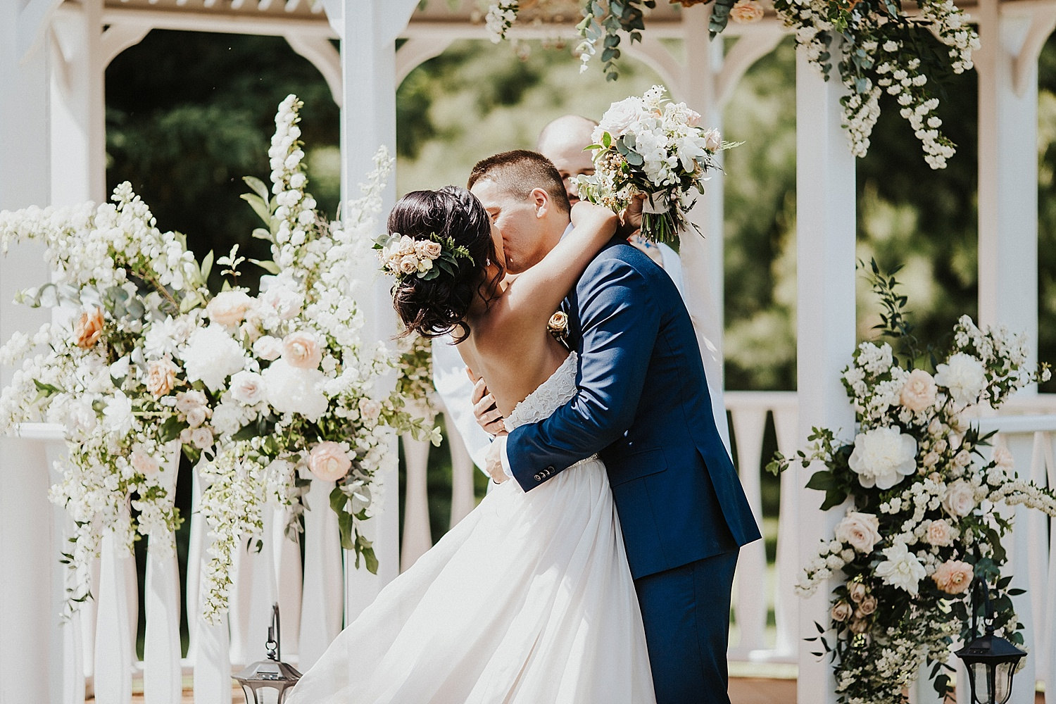 Wedding ceremony, bride and groom kissing