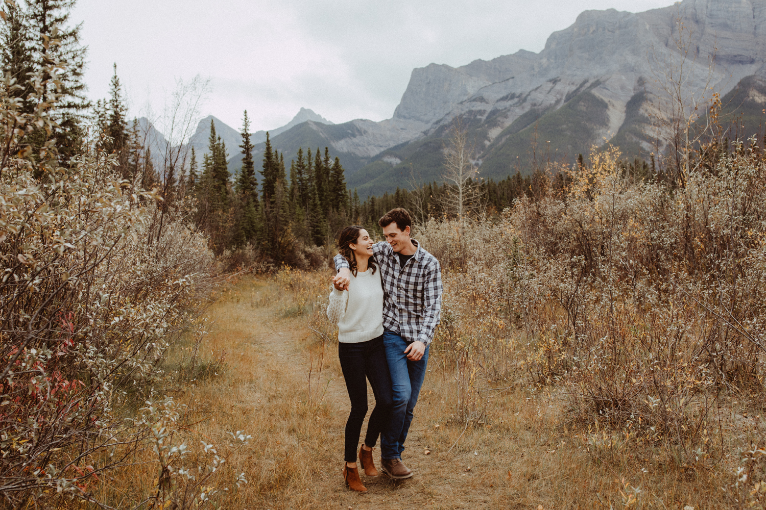 A couple walking in the mountains